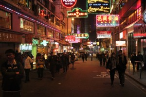 Hong Kong - flood of adverts and neon lights; endless stream of people.